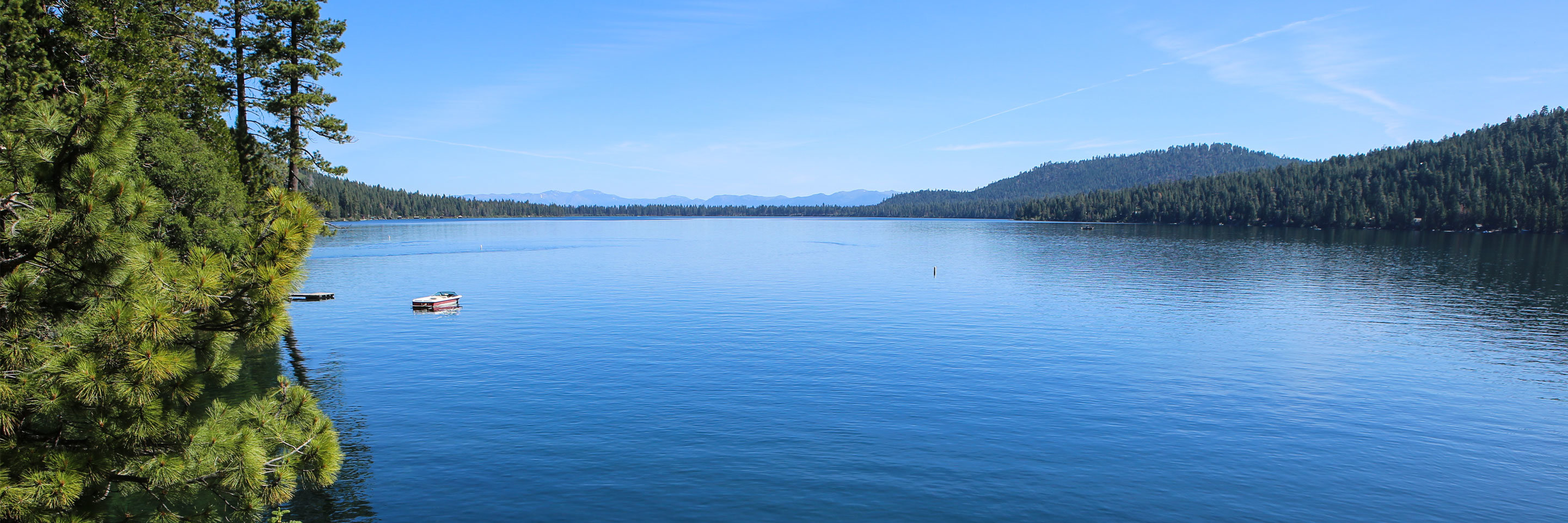 A panoramic view of a lake during the day
